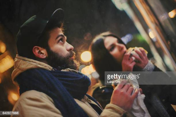 Couple eating on the street