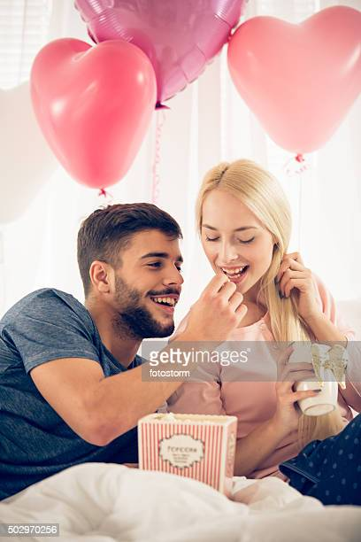 Couple eating popcorn together