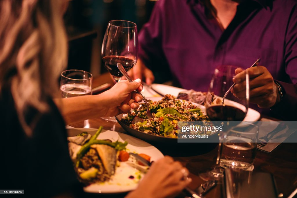 Couple eating quinoa salad and healthy dinner at restaurant : Stock Photo
