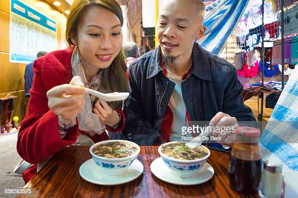 couple eating snake soup - porcelain stock pictures, royalty-free photos & images