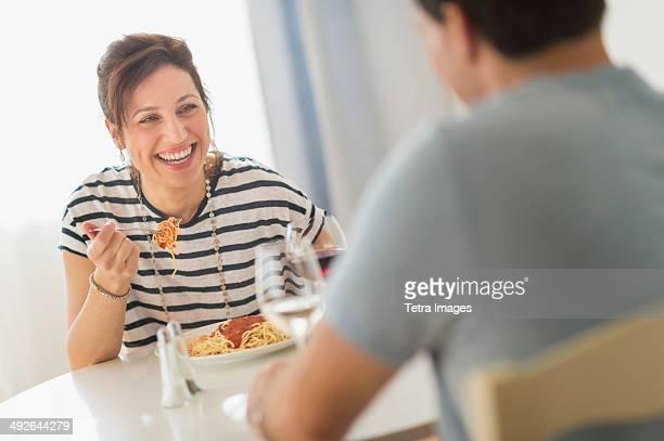 Couple eating spaghetti, Jersey City, New Jersey, USA