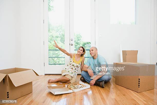Couple Eating Takeout Pizza in New Home
