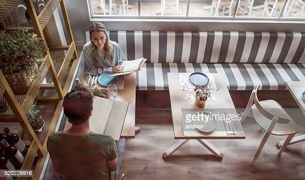 Couple eating together at a restaurant