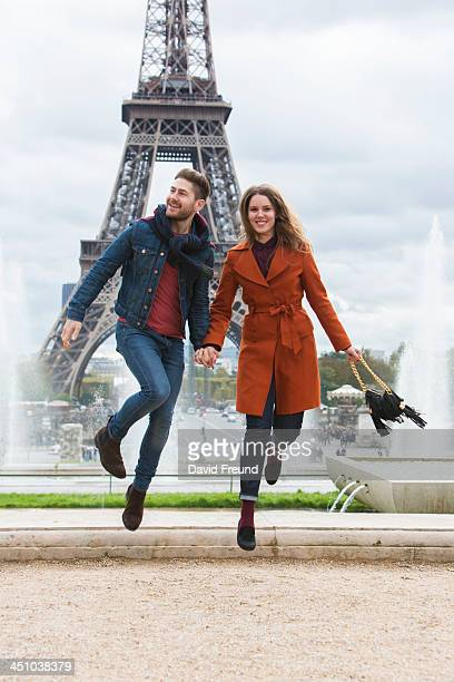 Couple Eiffel Tower Jumping