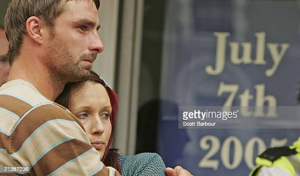 A couple embrace as they observe a twominute silence at Kings Cross Station at midday to mark the first anniversary of the London bombings on July 7...
