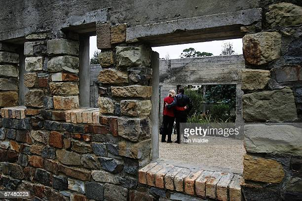 Couple embrace at the site formerly known as the Broad Arrow cafe during a commemoration service to mark the 10th aniversary of the massacre April...