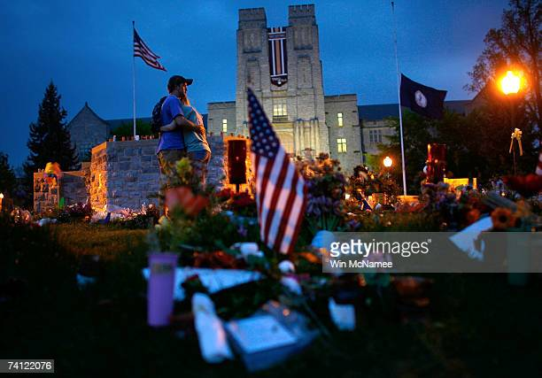 A couple embrace each other as they pay their respects at a memorial to the 32 students and faculty killed in the Virginia Tech shootings at the...