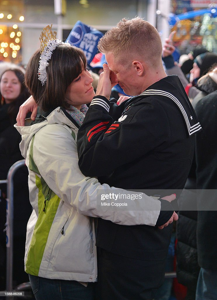 A couple embrace each other during New Year's Eve 2013 In Times Square at Times Square on December 31, 2012 in New York City.