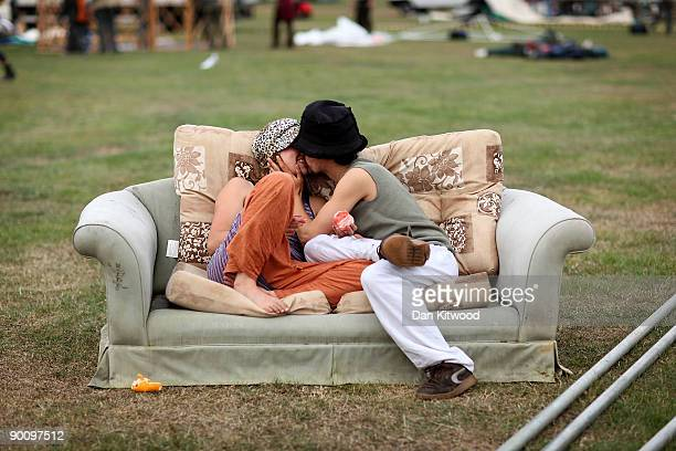 Couple embrace on a sofa at the Climate Camp on Black Heath on August 26, 2009 in London, England. Protesters are due to occupy an area of London for...