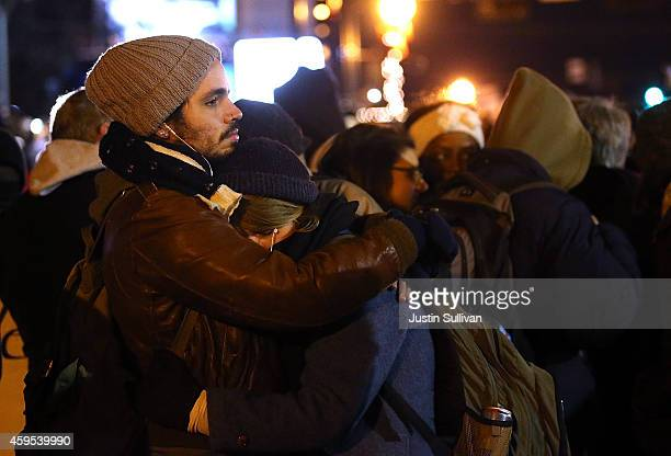 A couple embraces as a grand jury's decision is delivered on November 24 2014 in Ferguson Missouri A St Louis County grand jury has decided to not...