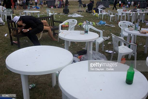 A couple embraces as the littered grounds show the aftermath of picnics at the Royal Ascot After over a decade of Labour Government in Great Britain...
