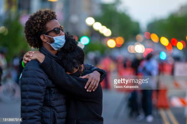 Couple embraces at Black Lives Matter Plaza near the White House on April 20, 2021 in Washington, DC. Former police officer Derek Chauvin was on...