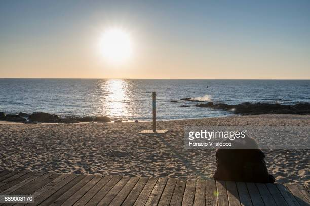 A couple embraces at sunset by the beach near Restaurante Tony Angeiras beach during the visit by participants of Gastronomic FAM Tour on December 02...