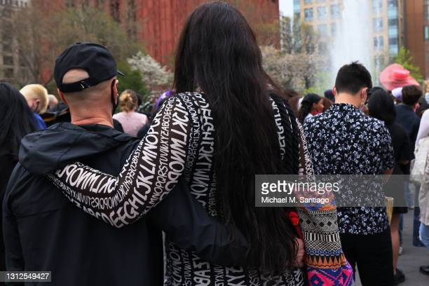 Couple embraces during a vigil for Daunte Wright and Dominique Lucious at Washington Square Park in Manhattan on April 14, 2021 in New York City. The...