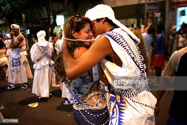 A couple embraces during Carnival on February 6 2005 in Salvador Brazil Centuries of slave trade with Central and West Africa has left 40 million...