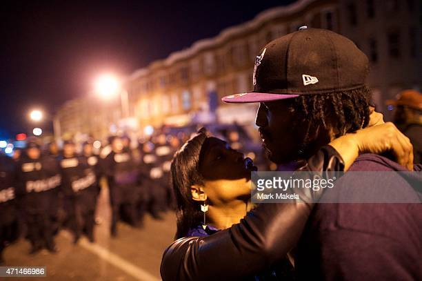 Couple embraces near riot police the night after citywide riots over the death of Freddie Gray on April 28, 2015 in Baltimore, Maryland. Freddie Gray...