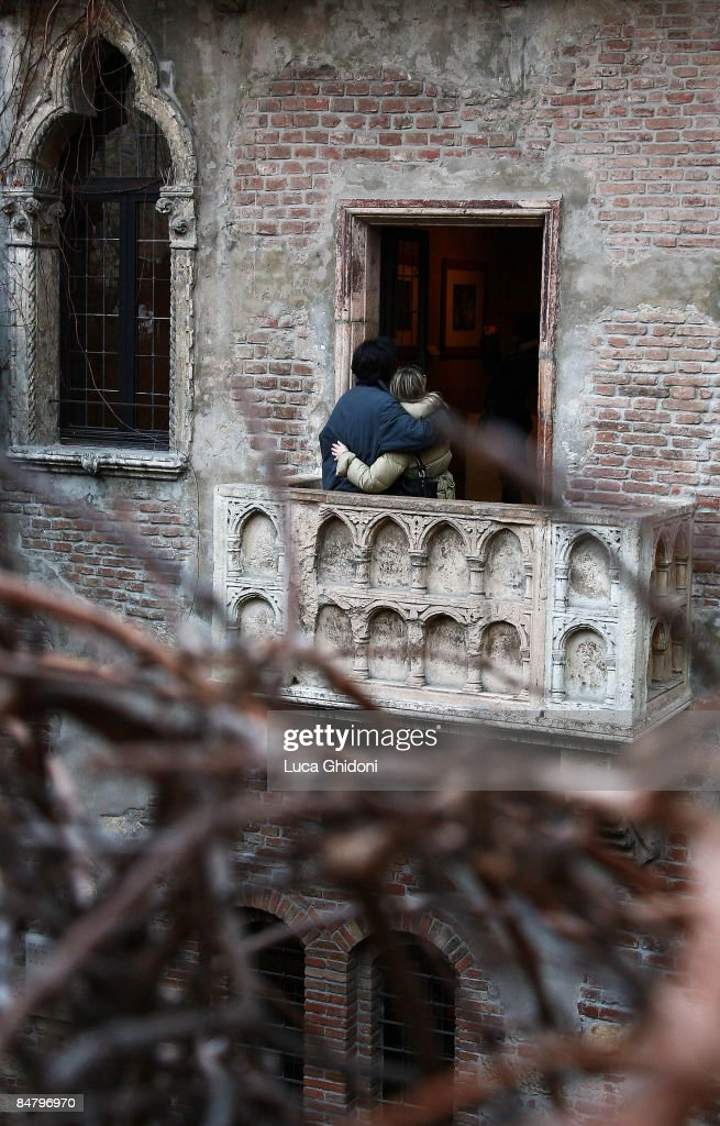 A Couple Embraces On What Is Known As Romeo And Julietu0027s Balcony On St.  Valentineu0027s