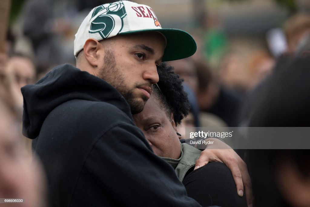 A couple embraces while listening at a march and rally in honor of Charleena Lyles at the apartment building in which she was killed on June 20, 2017 in Seattle, Washington. Officers from the Seattle Police Department shot and killed Lyles, a pregnant mother of four, on June 18.