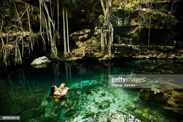 Couple embracing after exploring and swimming in cenote during vacation