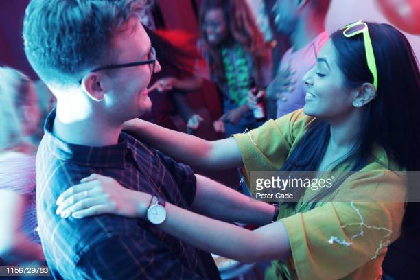 couple embracing at house party - entertainment occupation stock pictures, royalty-free photos & images