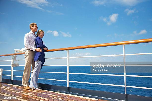 couple embracing at rail on deck in the caribbean sea aboard holland america line's westerdam, february 2010 - honeymoon stock pictures, royalty-free photos & images