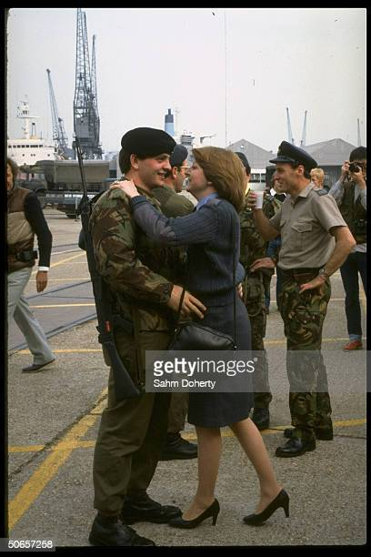 Couple embracing before soldier sails to Falklands on QE2