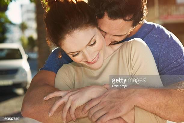 Couple embracing, close up