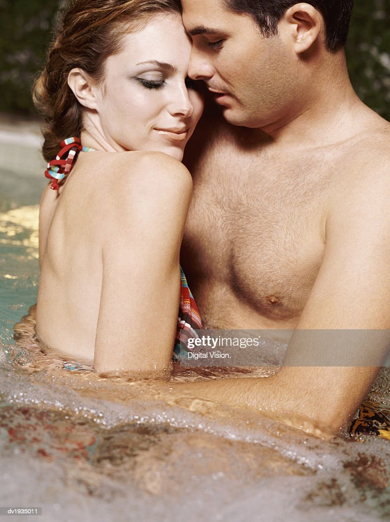 Couple Embracing Each Other in a Jacuzzi : Stock Photo