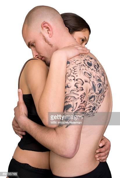 couple embracing each other - intim piercing stock-fotos und bilder