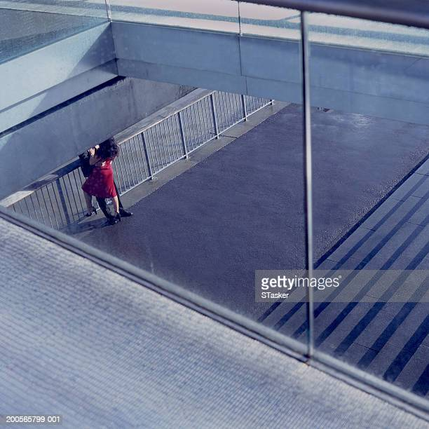 Couple embracing, elevated view