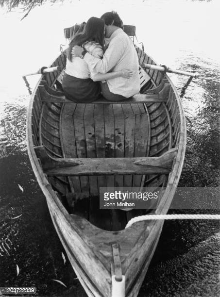 A couple embracing in a rowboat on the Serpentine in Hyde Park London 12th July 1971