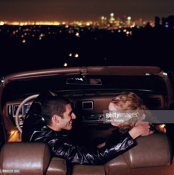 Couple embracing in car, Los Angeles, California, USA