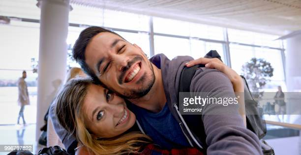 Couple embracing in departure lounge