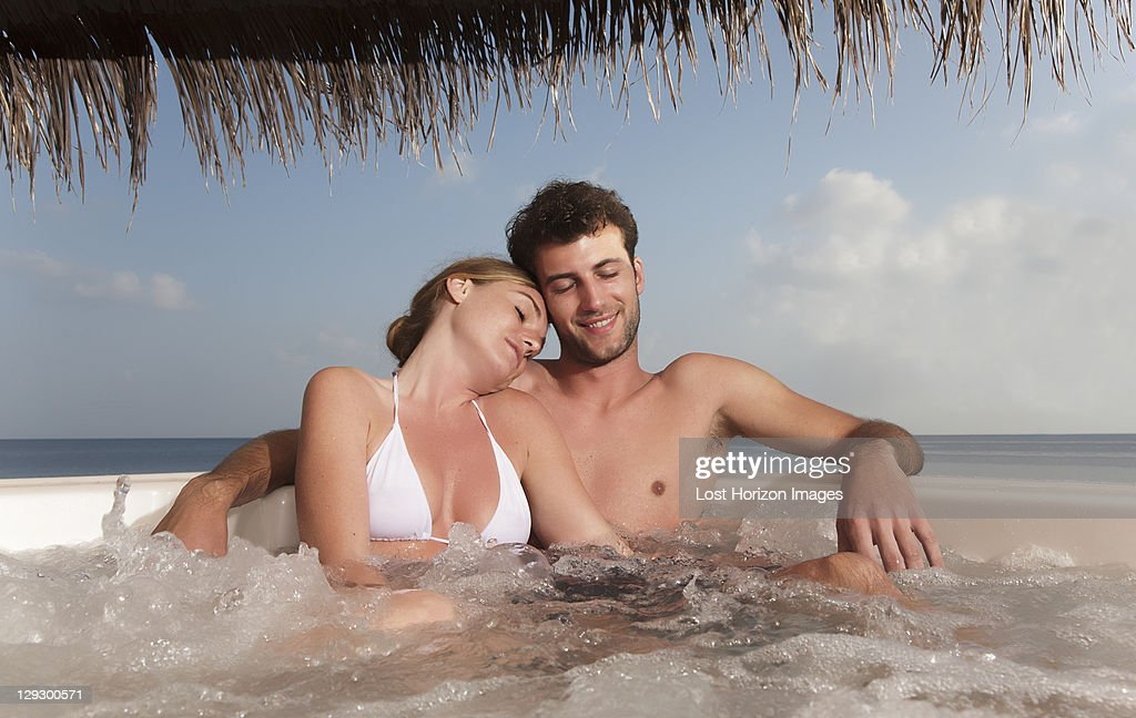 Couple embracing in hot tub : Stock Photo
