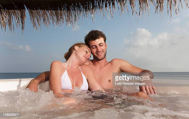 couple embracing in hot tub - hot tub stock photos and pictures