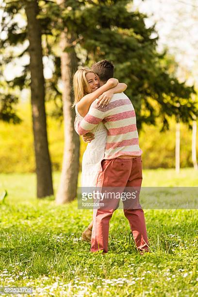 Couple embracing in park
