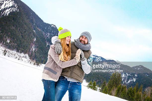 Couple Embracing In Snowy Landscape, Spitzingsee, Bavaria, Germany