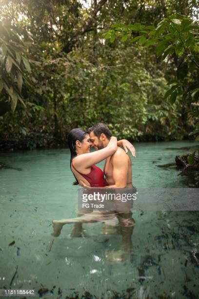 couple embracing in waterfall in tocantins, brazil - palmas tocantins imagens e fotografias de stock