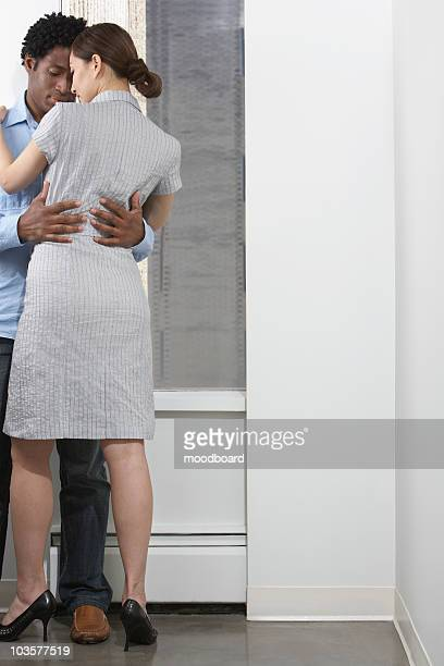 Couple embracing indoors