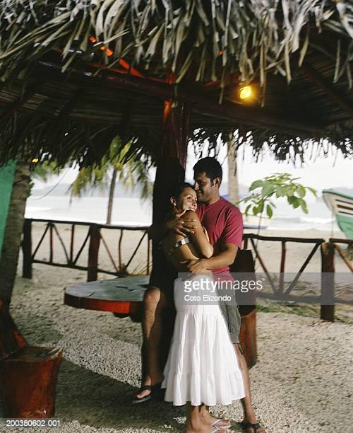 couple embracing near beach - playa carrillo fotografías e imágenes de stock