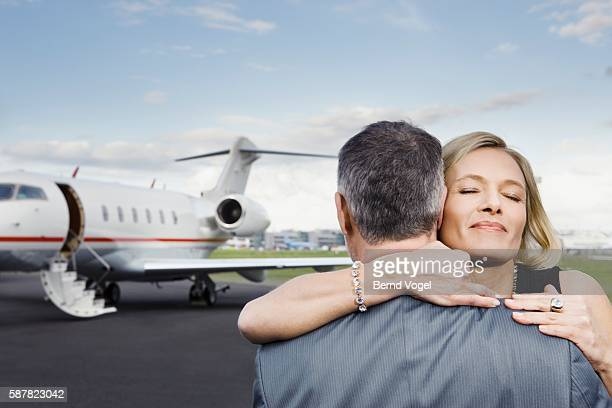 Couple embracing on airport runway