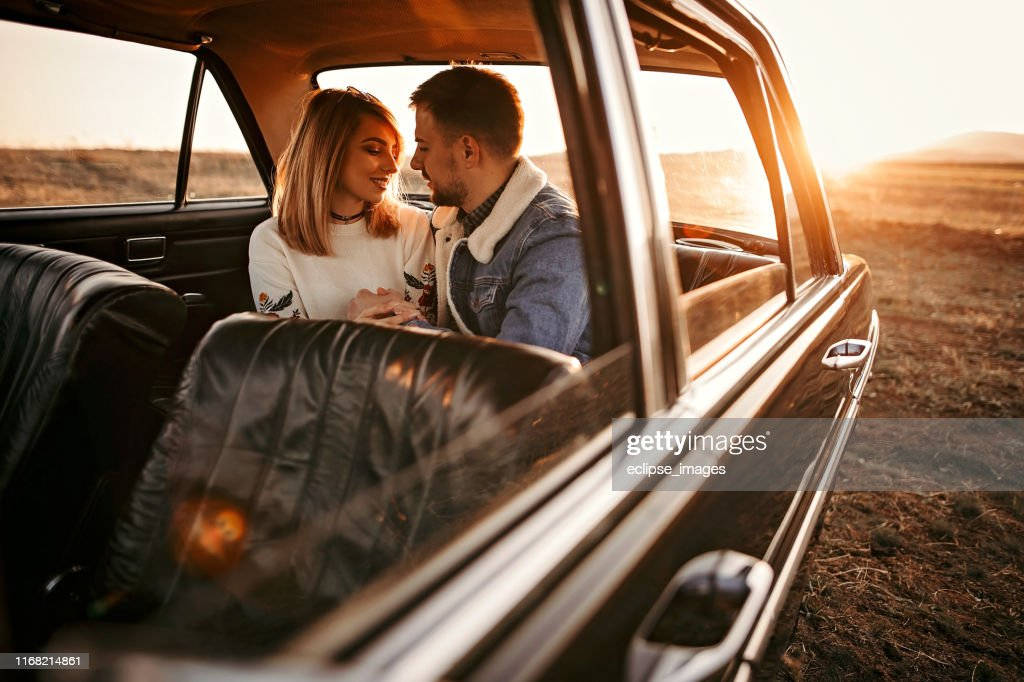 Couple Embracing On Back Seat Of The Car High Res Stock Photo Getty Images