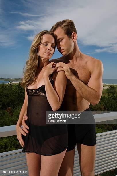 Couple embracing on balcony, close-up