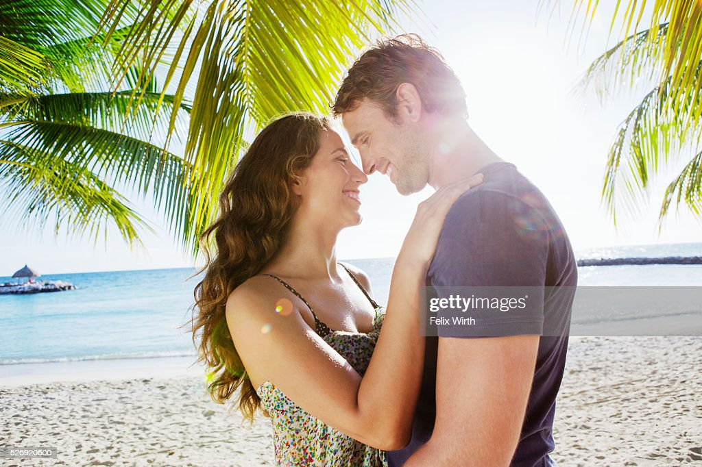 Couple embracing on beach : Stock Photo