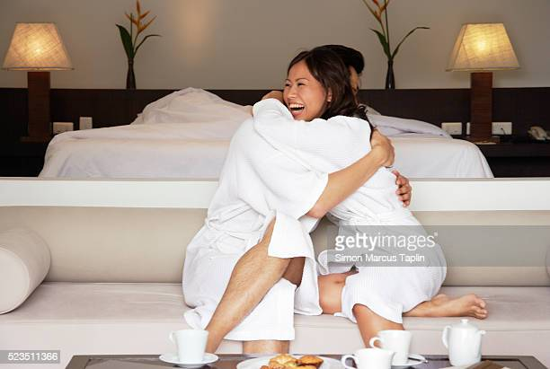 Couple Embracing on Couch