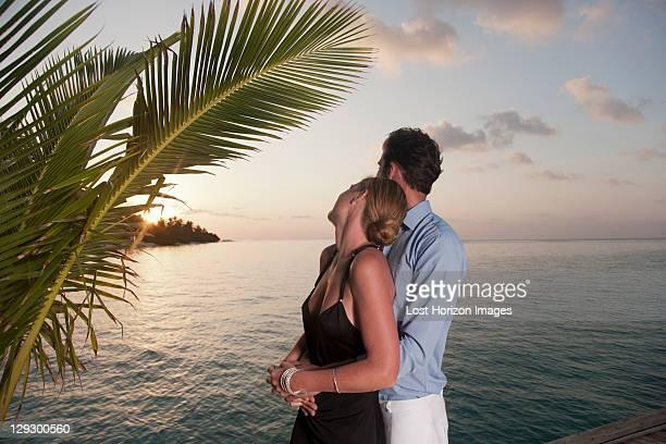 Couple embracing on dock