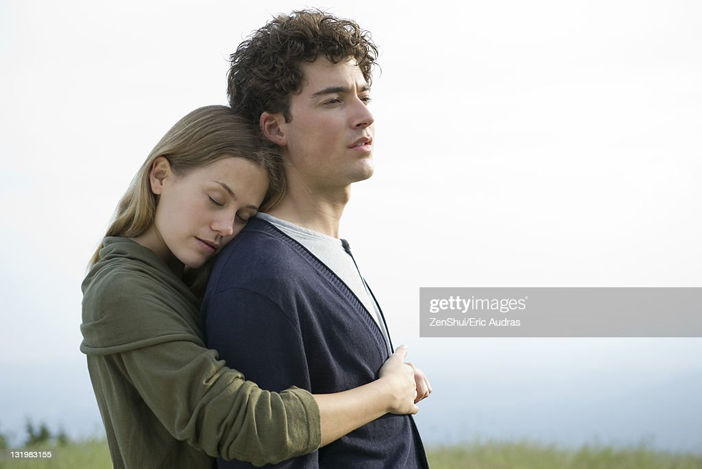 Couple embracing outdoors : Stock Photo