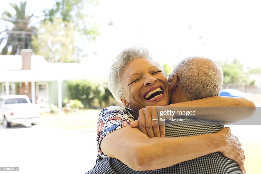 Couple embracing outdoors smiling : Stock Photo
