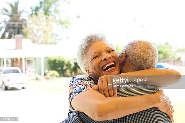 couple embracing outdoors smiling - overexposed stock photos and pictures