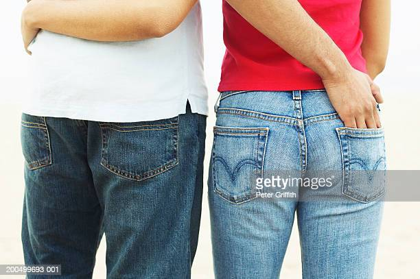 couple embracing, rear view, mid section - mains dans les poches photos et images de collection